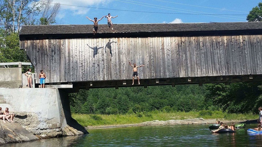 Crazy kids jump from Great Eddy covered bridge into the Mad River. Waitsfield VT shot from my inn...