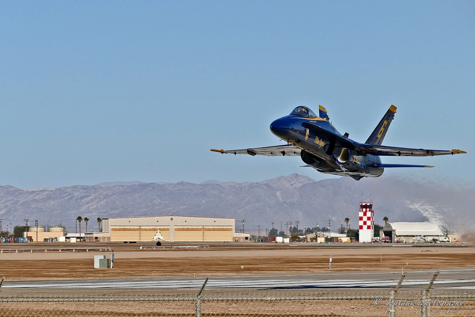 Blue Angels practice session in El Centro.  This fast low pass actually blew a photographer off o...