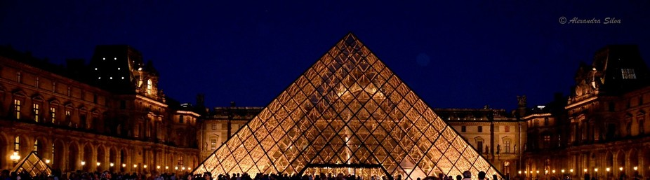 At the exit of the Louvre Museum, in a summer night.