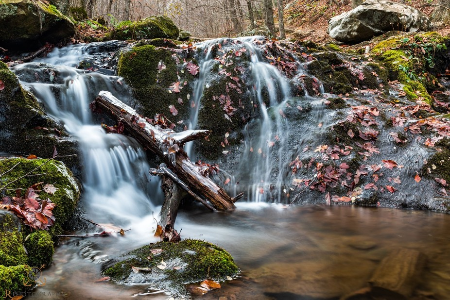 A simple waterfall above an even bigger fall. Had to get my feet wet for this one. Taken on Skyli...