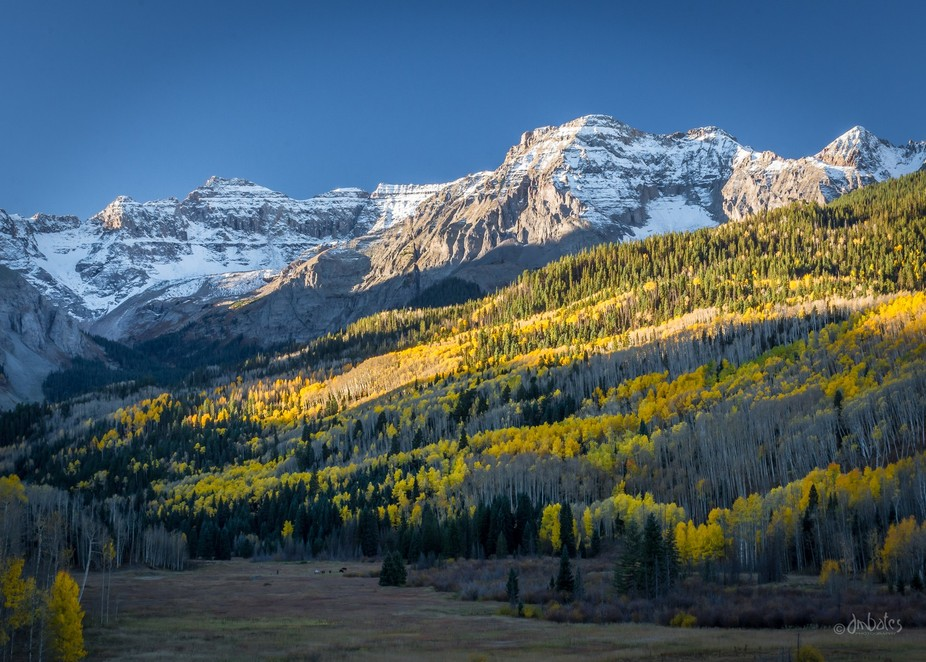 Taken in the San Juan Mountains of Colorado. In the left foreground you can see a wrangler and hi...