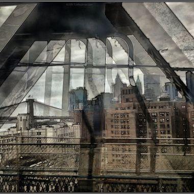 The Brooklyn Bridge from the Manhattan Bridge with NYC lower manhattan skyline.