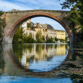 this photo shows the bridge of concord that is located in the region of the Marche in Italy