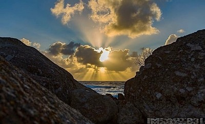 Storm clouds off the coast did thier magic duffusing the sunset inti bands of light reaching in all directions