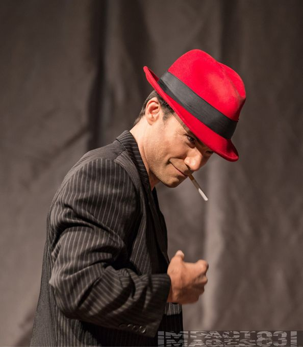 The man in the red hat...using focused stage lighting in this candid image