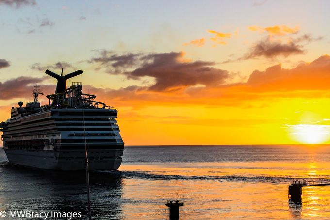 Cruise ship leaving Rousseau, Dominica as the sunsets on the Carribean