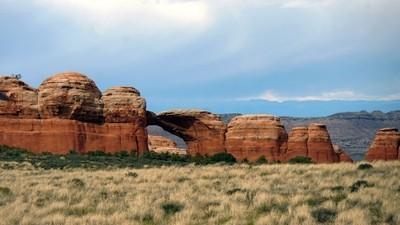Red Rock Arch Under Dark Clouds