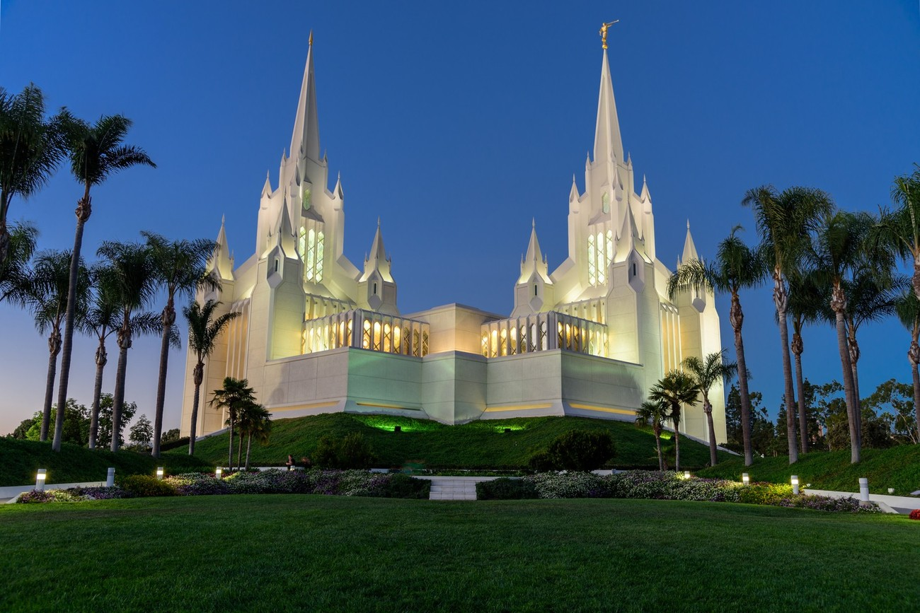 The San Diego LDS Temple, 7474 Charmant Dr, San Diego, CA. Night image with temple lights on just after sunset.