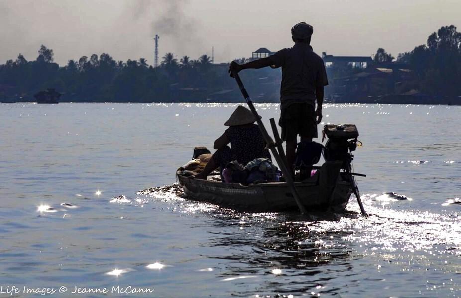 Sailing on the Mekong River.
