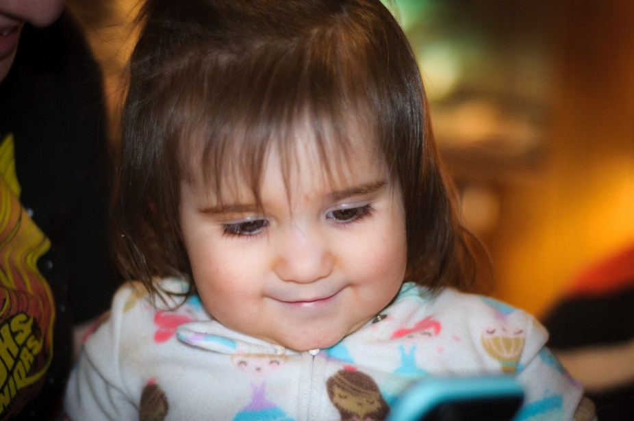 My Granddaughter watching a video of her father who is away in the Army