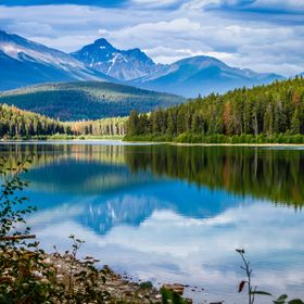 Reflection on small lake at the Canadian Rockies.