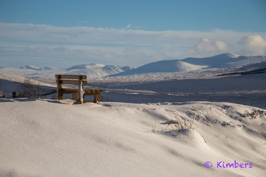 Heavy snow overnight in Glencoe - the bench sits near the main road towards Fort William