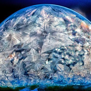 Frigid temperatures and a colorful sunrise lead to unique frozen bubbles.