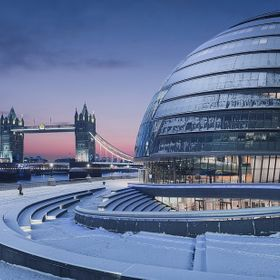 Early-morning snow covering the walkway near City Hall and Tower Bridge, London