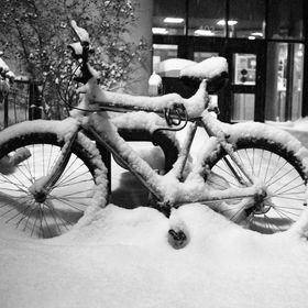 Bicycle left during a snowstorm