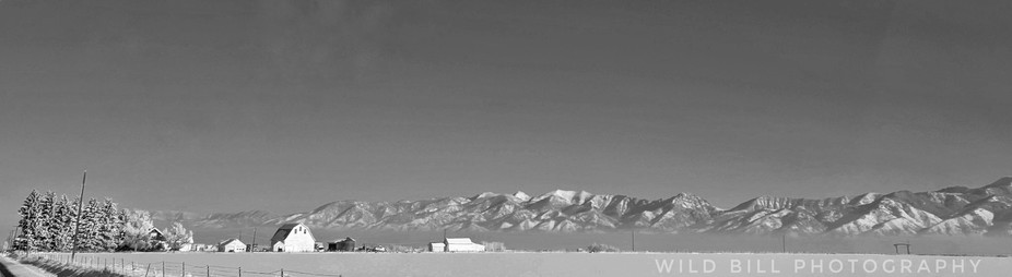 White barn with the mountains