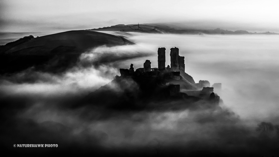 The 1000 year old Corfe Castle ruins standing proud above the morning mist...