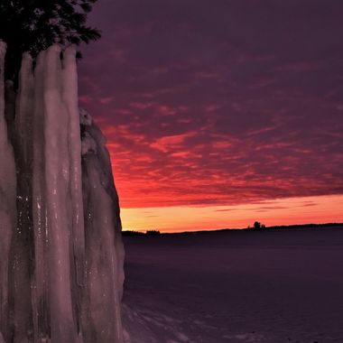Taken on an outing with the camera club shooting the sunset on Rainy Lake along the ice road in Voyaguers Nat'l Park  Nikon D3400 used a flash to backlight the ice