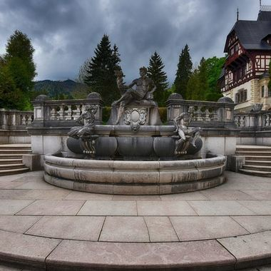 Fountain in front of Peles Castle in Romania