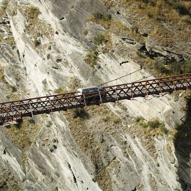 a single lain  bridge  in one of the canyons in south island New Zealand