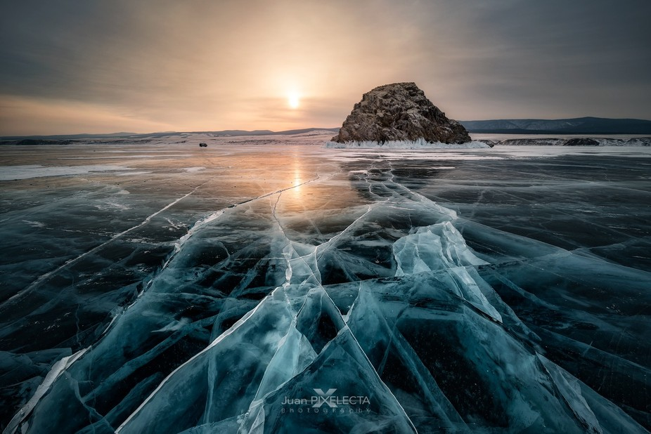 THE PLACE: Lake Baikal. A small island that the water bathes its coast with white and blue ice. T...