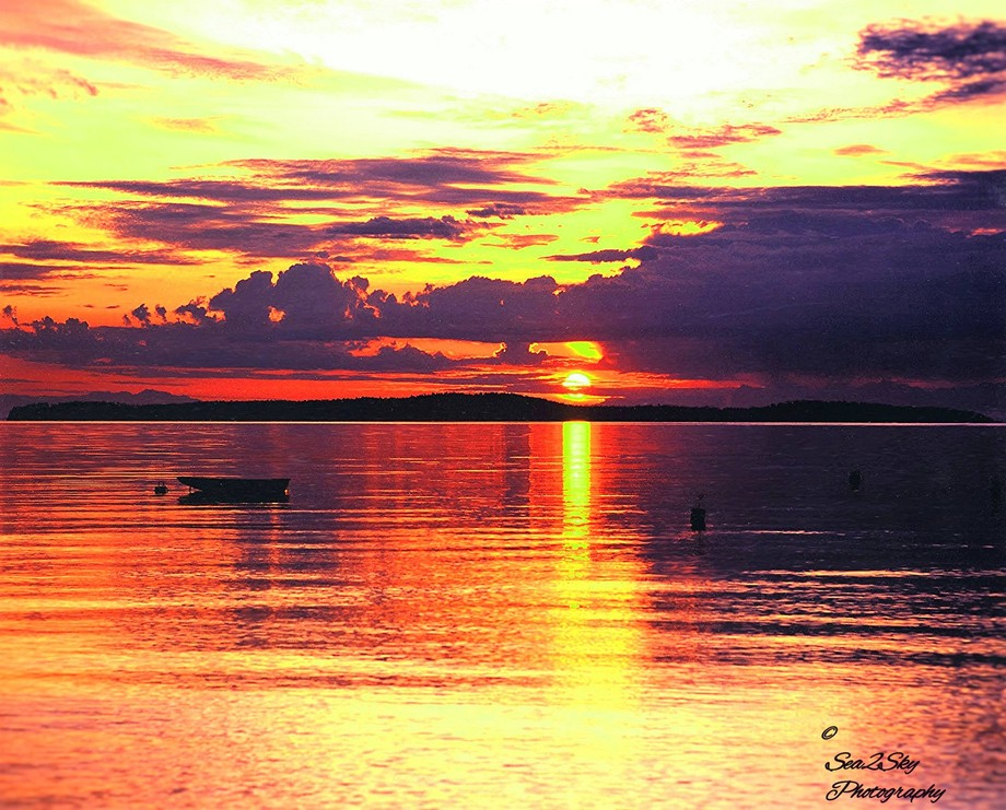 On Waldron Island in the San Juans, an early summer sunrise looking east over Sucia Island in the...