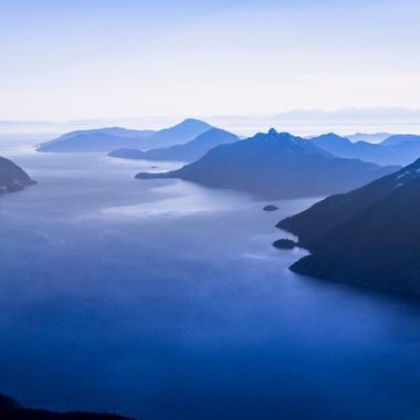 Aerial shot of beautiful Howe Sound. Ocean Inlet from the Pacific Ocean mixing with the Glacier water running down from the Valleys.