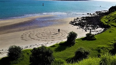 Artist on the beach in New Zealand Mount Maunganui