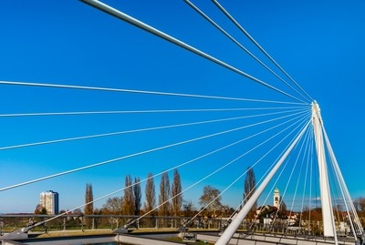 Passerelle pedestrian bridge over the Rhine between Kehl (Germany) and Strasbourg (France). Sunny day.