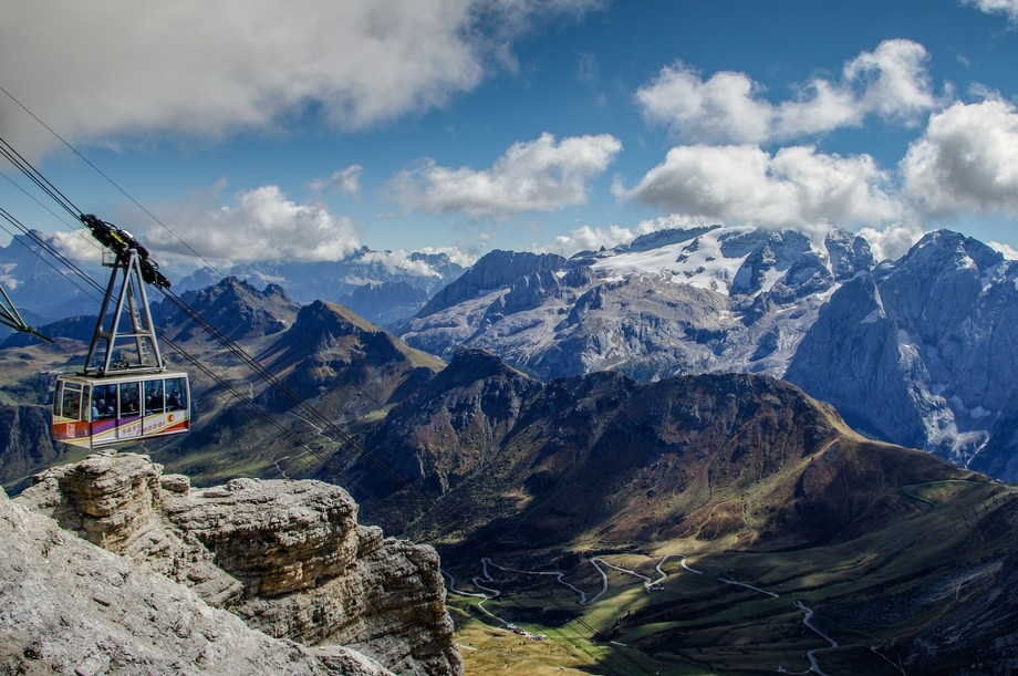 Cable car in the Dolomites with the snowcapped mountains beyond