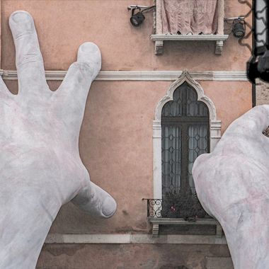 I took this shot on a wet day in Venezia, highlighting the beautiful hands sculpture on the Grand Canal.