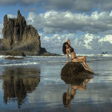 Model sitting on a rock in Benijo Beach, Tenerife
