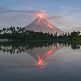 Night spew together with a perfect reflection of the most iconic volcano in the Philippines.