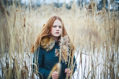 Redhead girl in reeds