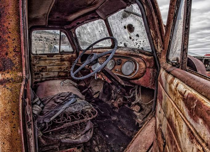 Old truck resting in a farm paddock slowly rusty away all it's tales.