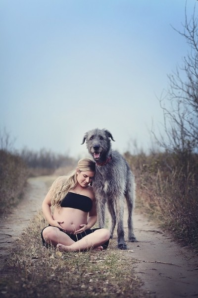 A pregnant woman and her dog