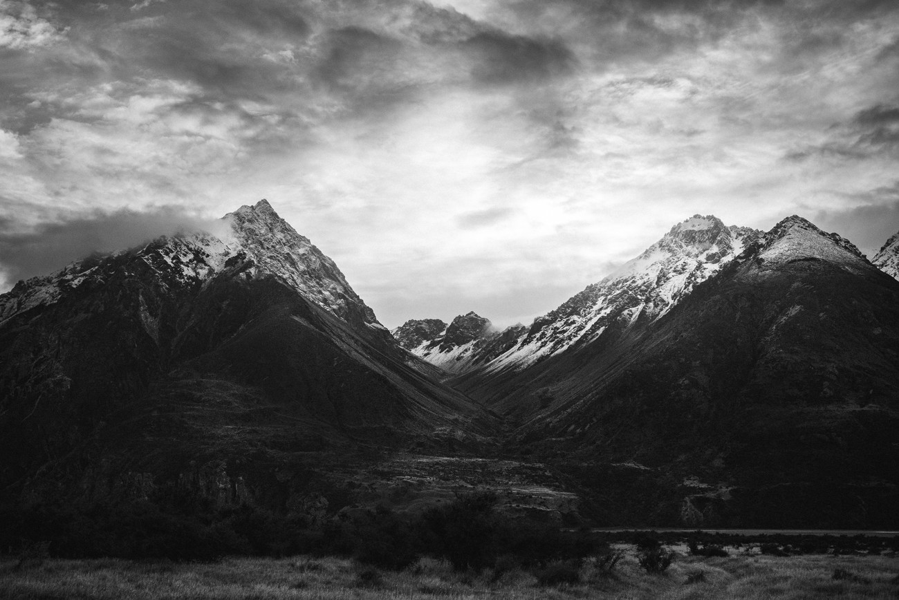 The day I planed to climb Mount Ollivier I woke up once with sunrays coming to me between these two peaks in Aoraki/Mount Cook National park, New Zealand and loved the way the light reveals the two peaks. What a great start for that day !