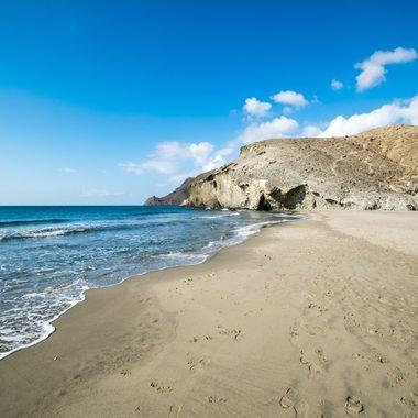 a peaceful beach scene taken at Monsul Beach in Almeria, Spain