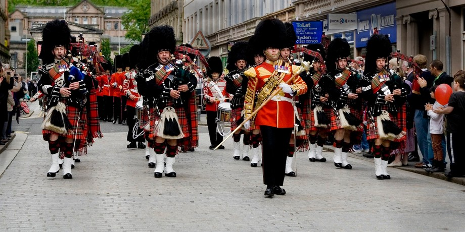 Band marching through  Dundee Scotland.