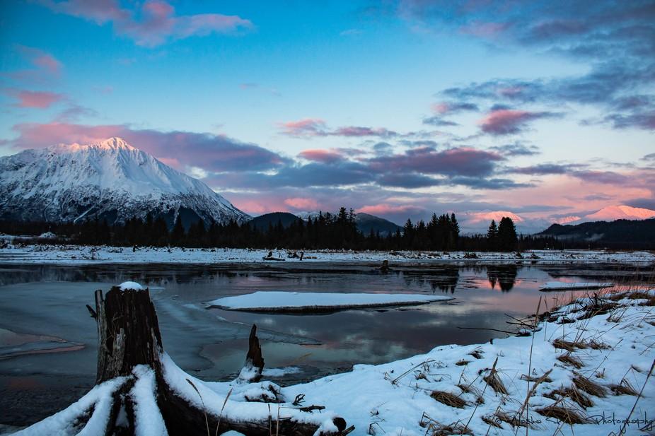 Pinks and blues surround this mountain peak in Seward, Alaska