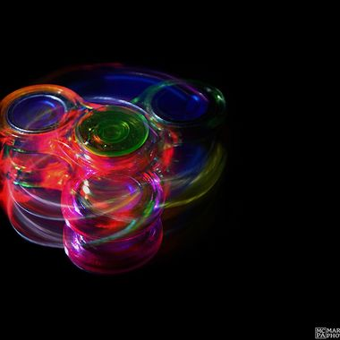 Spinner lit by a single LED and a laser pointer, spinning on a flat mirror.