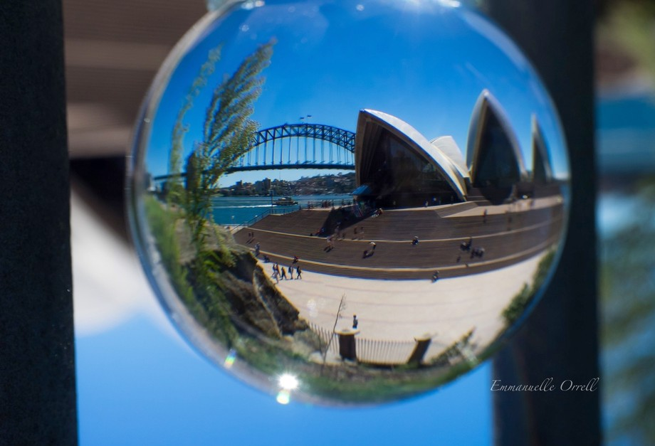 Refraction of the opera house and Sydney bridge in a crystal  ball, taken from the botanical garden