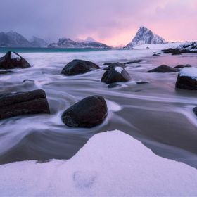 Sunrise breaking through an early morning winter storm in the Lofoten Islands of Norway.