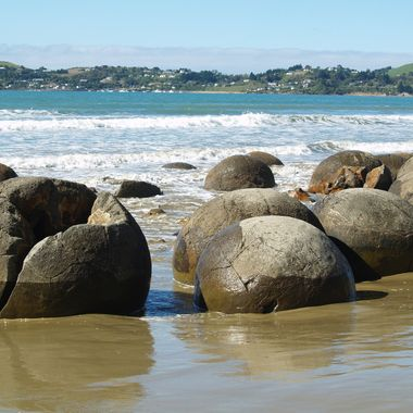 these are  round bolder's  that no one how they where formed they are scattered along the beach