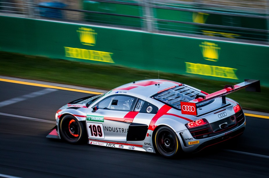Audi R8 GT lighting up the front brakes in the twilight Australian GT race at the 2018 Australian Grand Prix