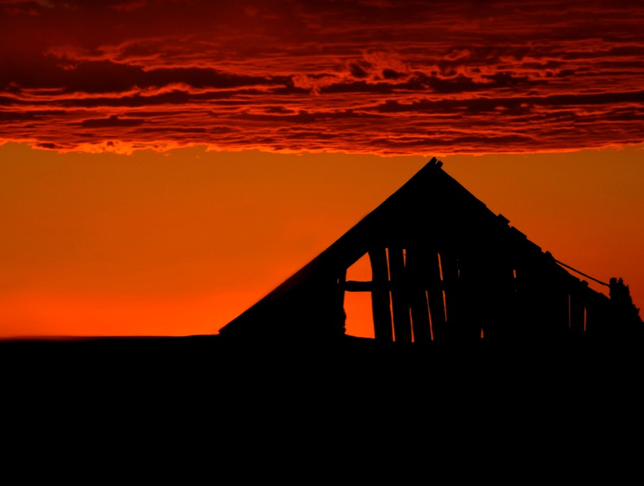 "From our Northern New Mexico property, at 8,100 ft elevation, brilliant sunsets are very common. This old shed sits on an adjacent field. Throughout the year it has made for a number of interesting images. Details"" Canon EOS D60, Canon 28-135 mm IS lens at 135 mm, ISO 100, f/16, 1/20 sec."