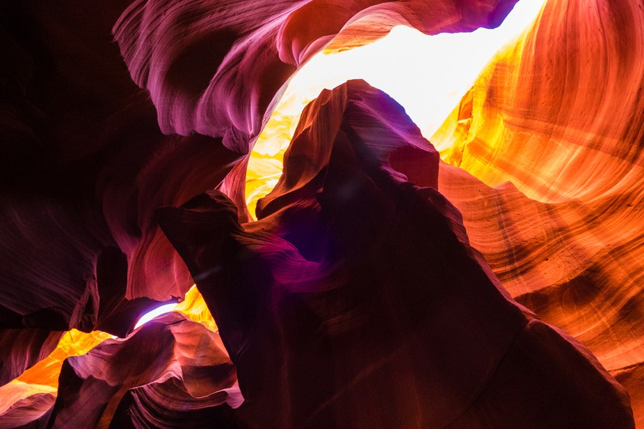 Looking up into the sky while trekking through Upper Antelope Canyon in late March.  This particu...