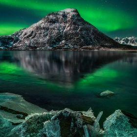 This photo was taken during a perfect clear night on the Lofoten Islands. The moon was lighting up the ice and snow while the nothern lights were...