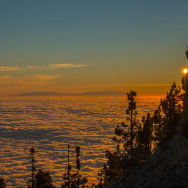 Photo taken in the Volcano Teide National park . Sea of clouds and at the back, the island of La Palma.