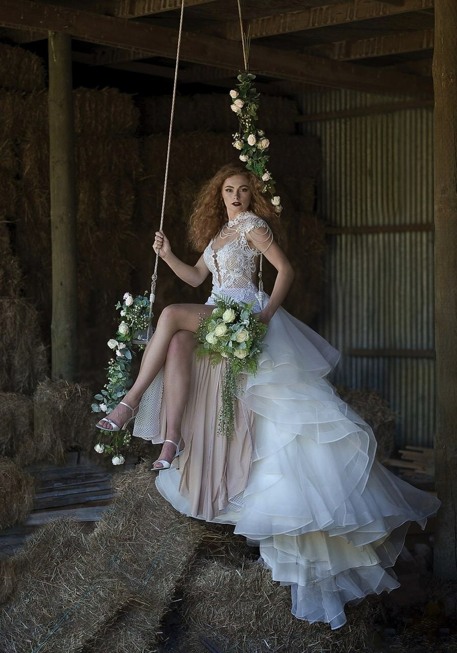 A bride on a swing in a hay shed. Just a normal wedding photo. :) by Dolceweddingphotography - Weddings And Fashion Photo Contest